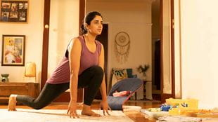 Woman stretching during a home exercise class