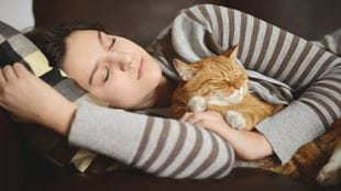 Woman asleep with cat