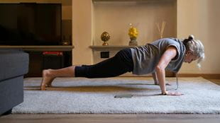 Woman doing push ups at home