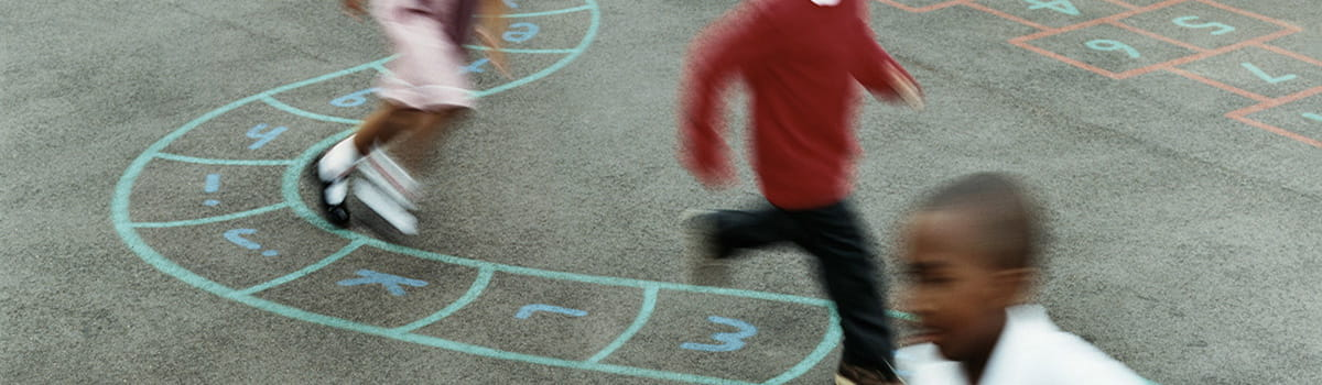 Kids playing hopscotch at school