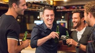 Group of men at pub drinking beer