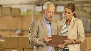 Man and woman in warehouse