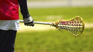 Teenager holding a lacrosse stick